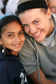 A young camper and her college age counselor at Point O'Pines Camp for Girls