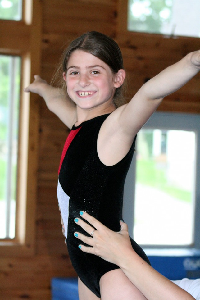 An aspiring gymnast reaches new heights thanks to a helping hand