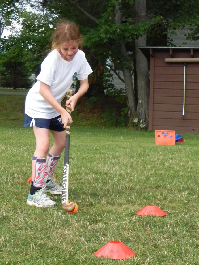 A camper practicing her dribbling