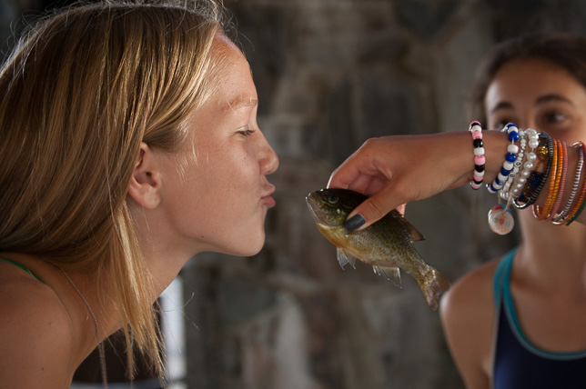 Is she really going to kiss that fish?