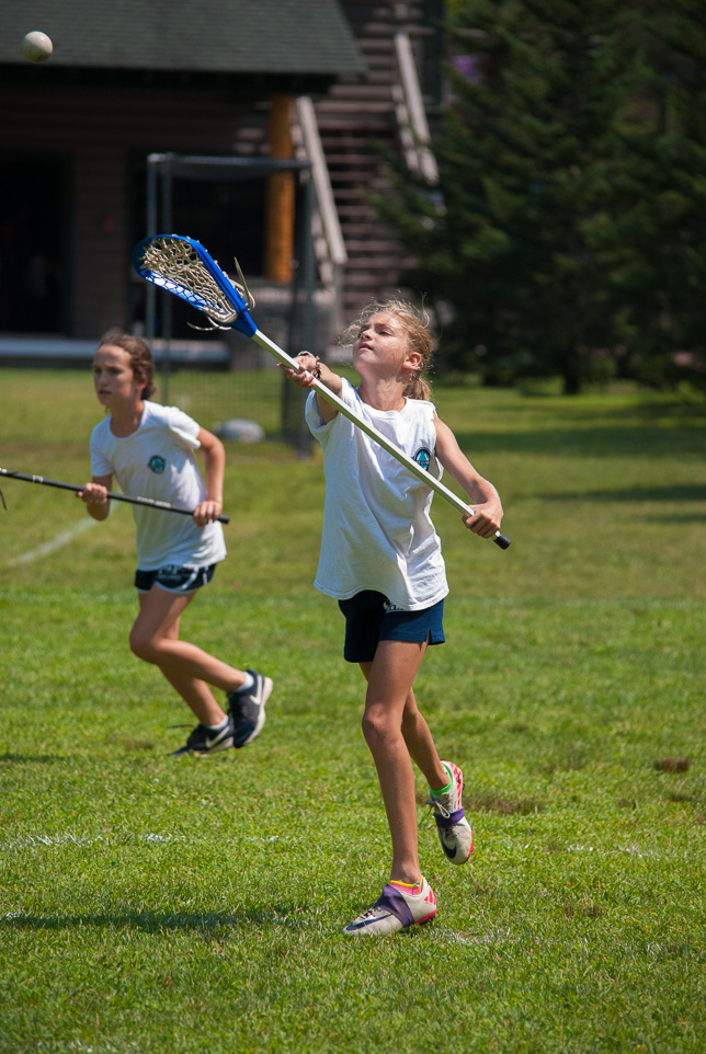 Camper passing lacrosse ball