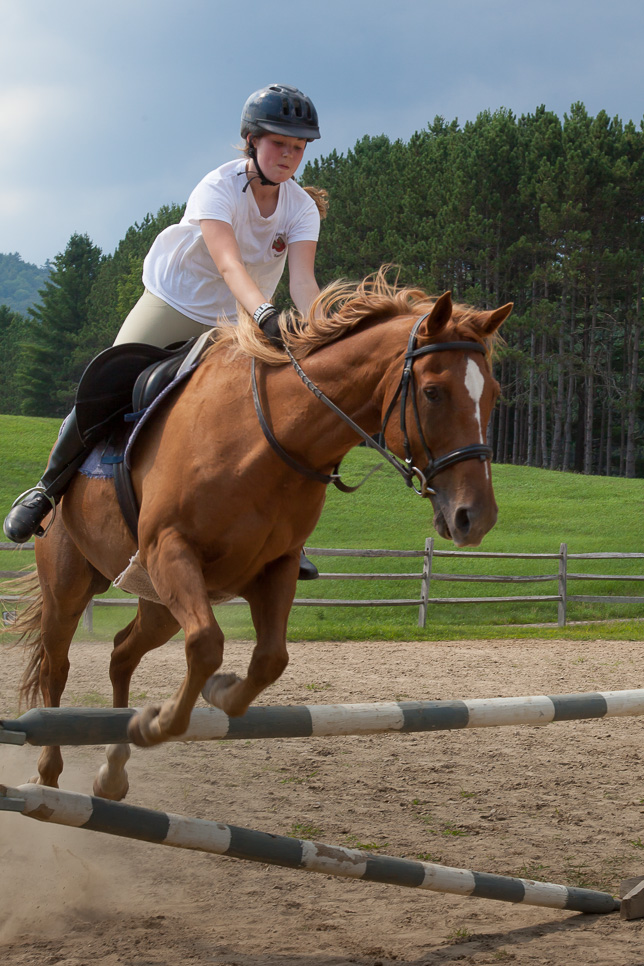 Campers practice jumping on horseback.