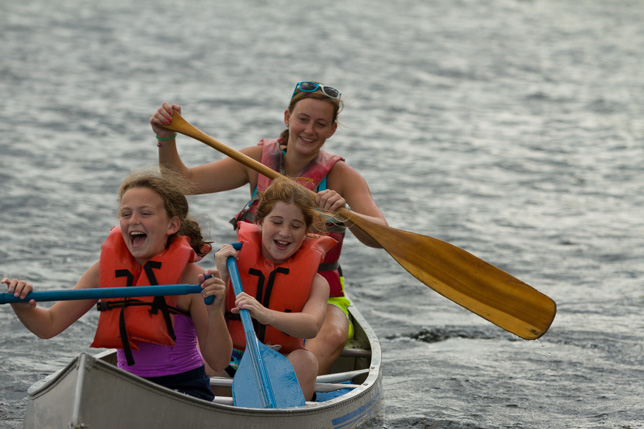 Campers canoeing to the Point O'Pines farm.
