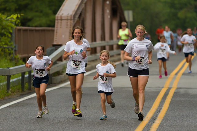 Campers running in the 5k race