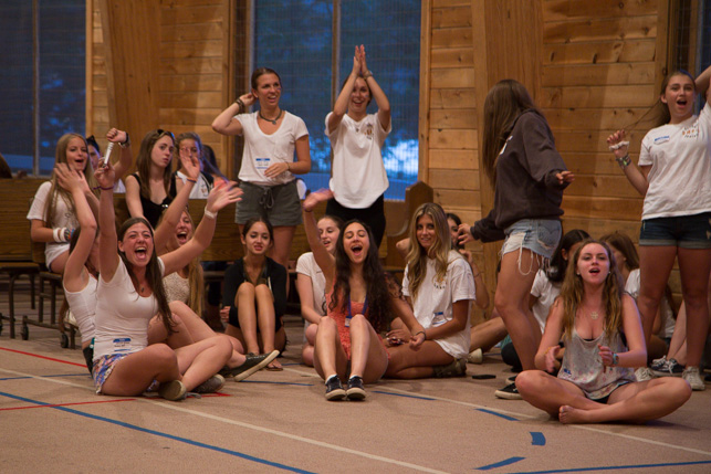 Alumnae playing evening activity with the campers.