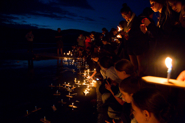 Lighting and launching wish boats into Brant Lake