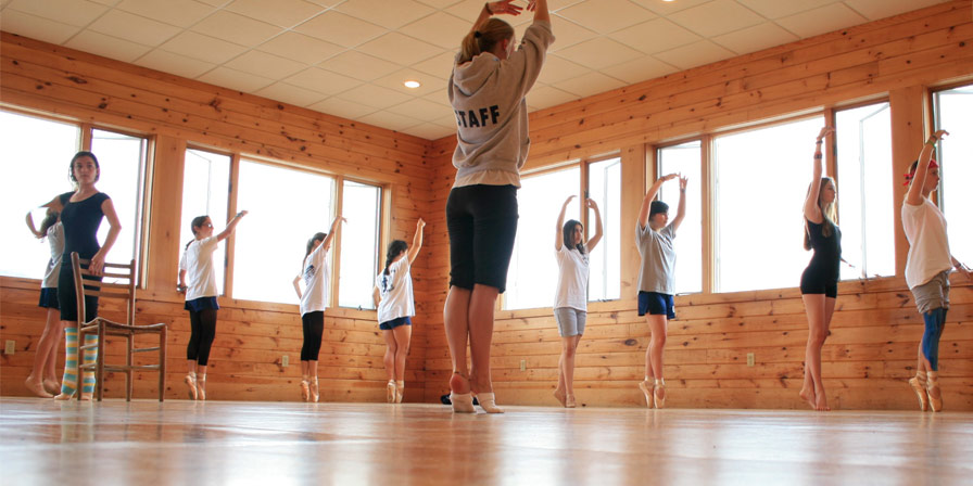 Campers and a staff member practice their ballet dancing