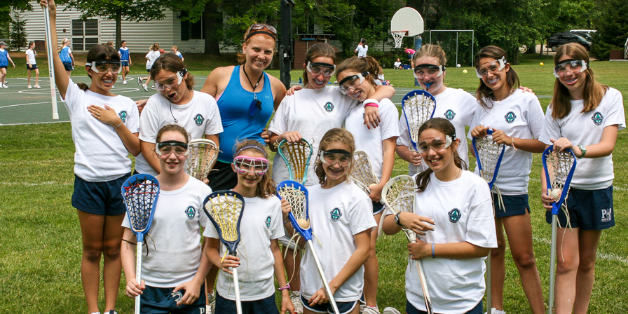 Campers all geared up for lacrosse with their instructor.