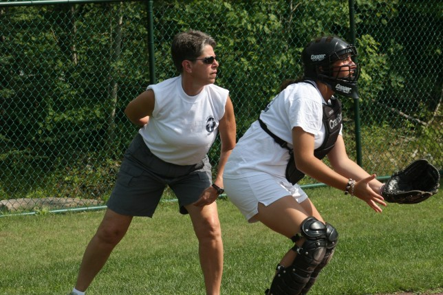 A key staff member acting as umpire at a softball game