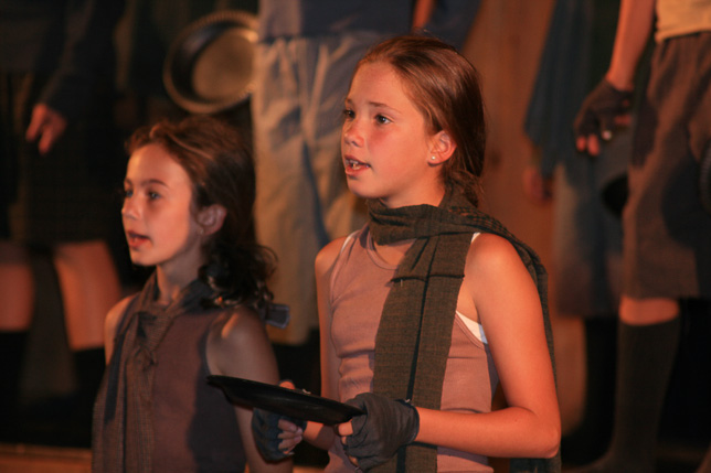 Campers singing in theater