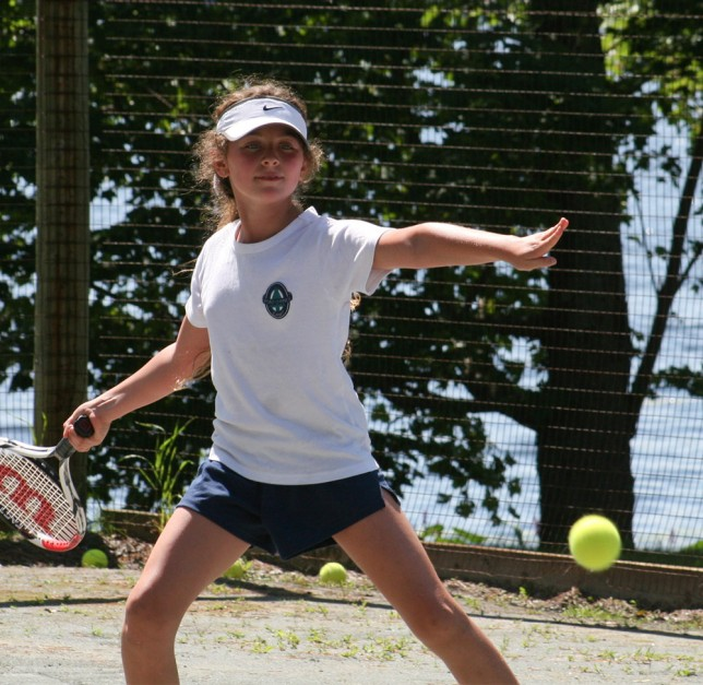 A camper prepares to return a serve