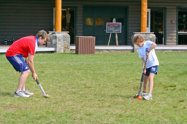 Instructor giving tips on Field Hockey Form