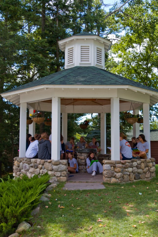 Girls meeting in a gazebo