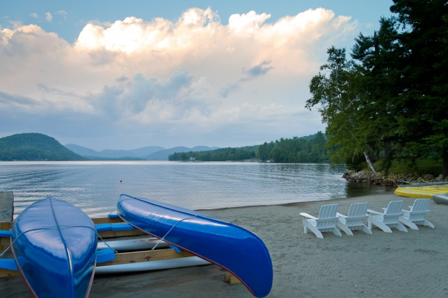 Canoes docked on the beach at Brant Lake