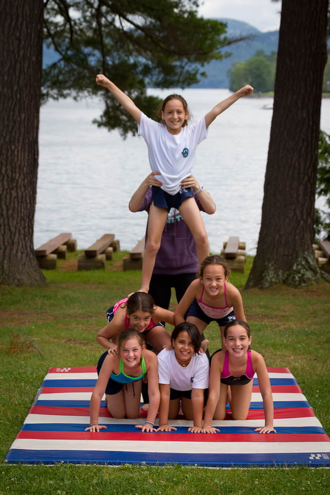Campers make a pyramid at gymnastics