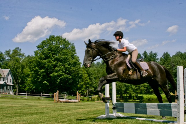 Camper practicing horse jumping