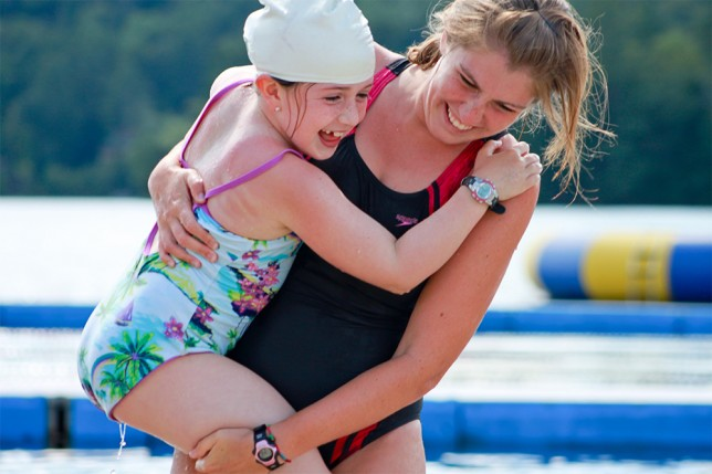 Counselor caring for camper