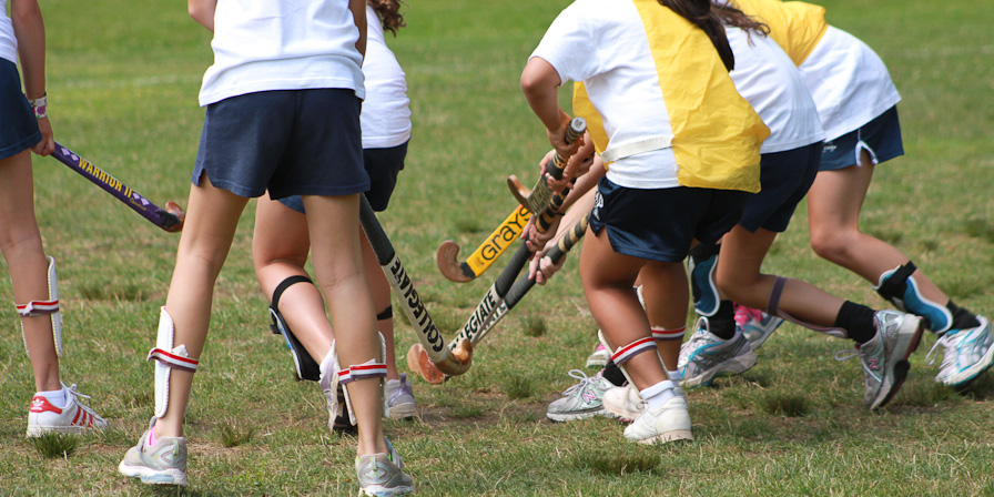 Campers playing Field Hockey