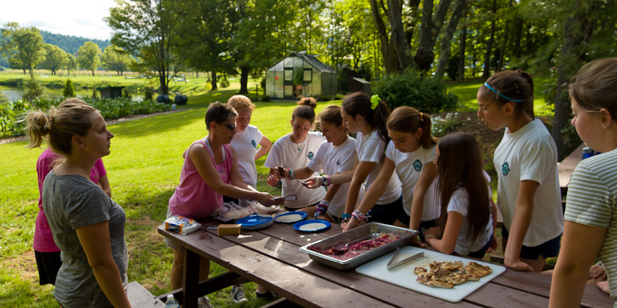 Campers and Sherie cooking in the great outdoors