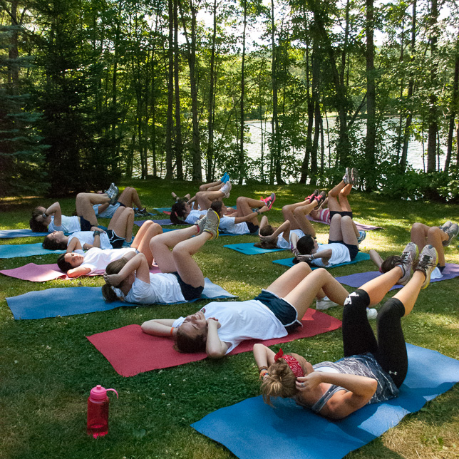 Campers practice yoga and good fitness.