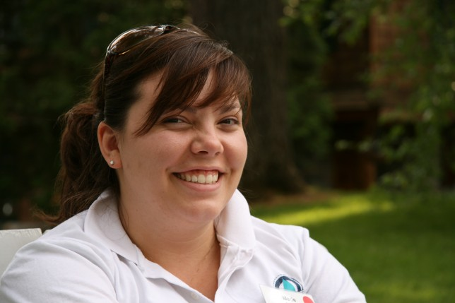 A staff member happy about working at camp.