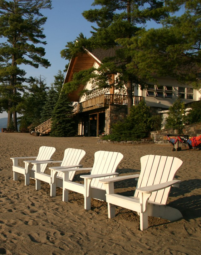 Adirondack chairs on the beach