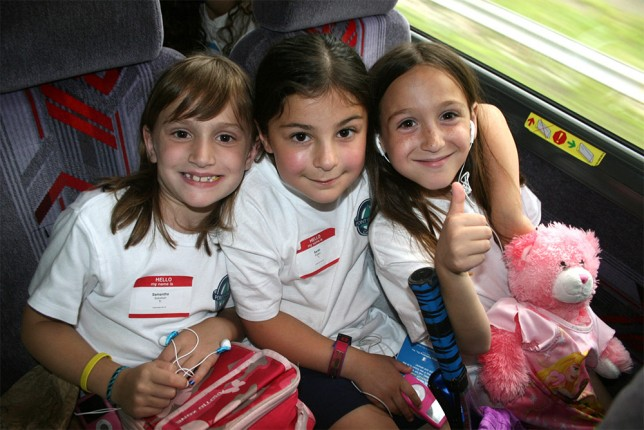 Young campers on the bus to camp