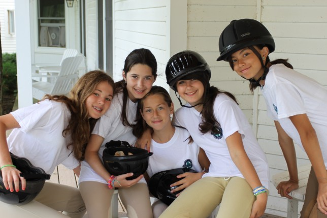 Campers in uniforms and riding attire