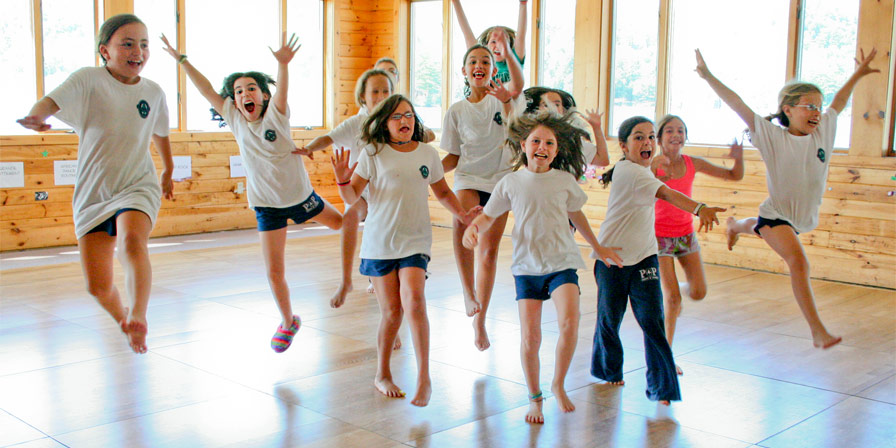 Young campers leaping in the Dance Hall