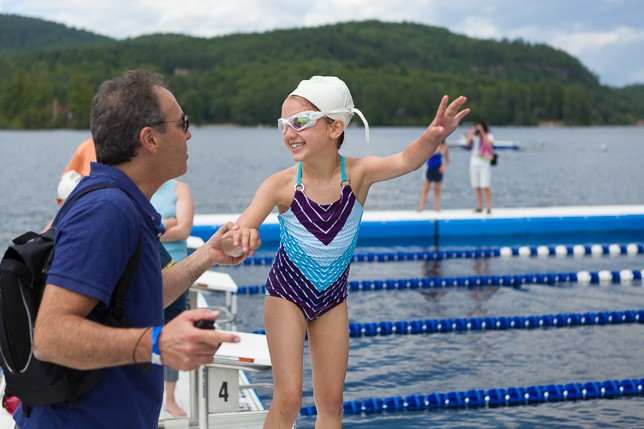 Camper shows her dad what she has learned on the waterfront.