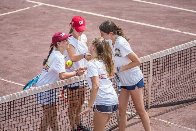 Tennis doubles game handshake showing great sportsmanship.