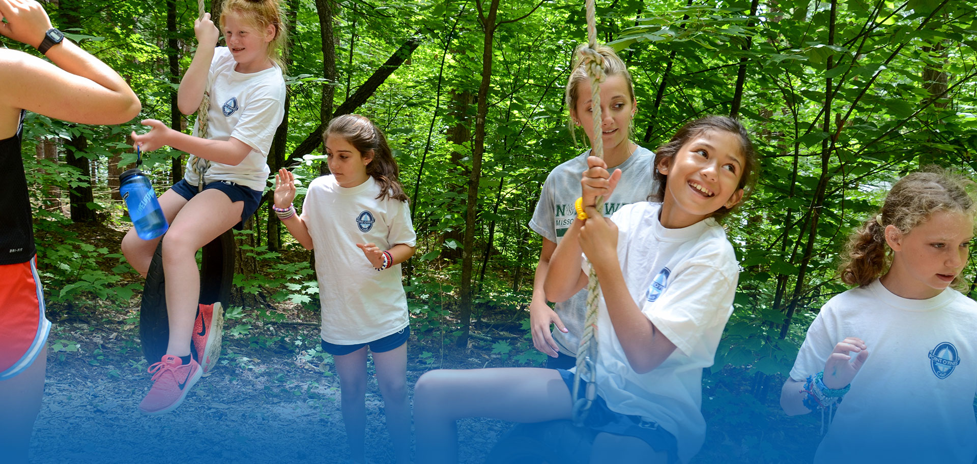 Campers on adventure course at overnight camp