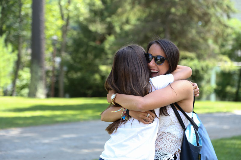 Hugs and friendship at sleep away camp in New York