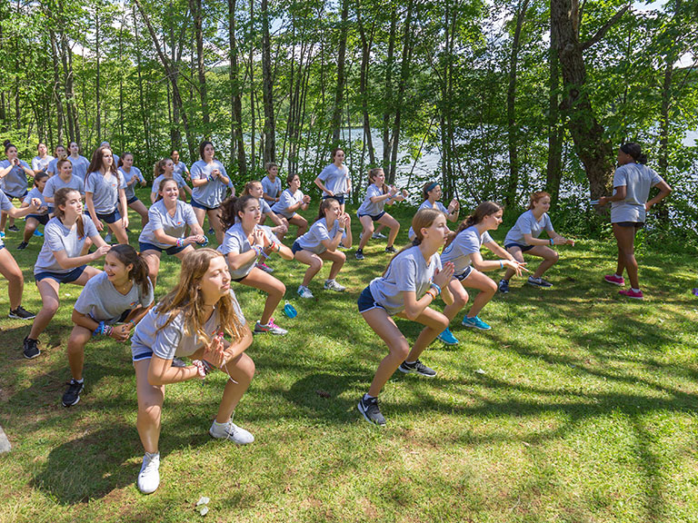 girl summer campers exercizing