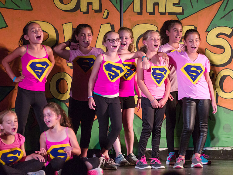 campers singing in a play