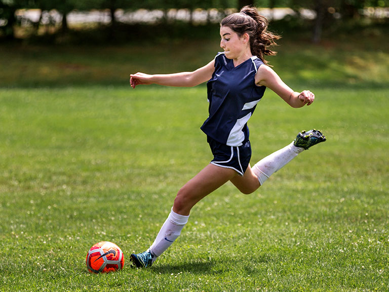 girl soccer player at summer camp