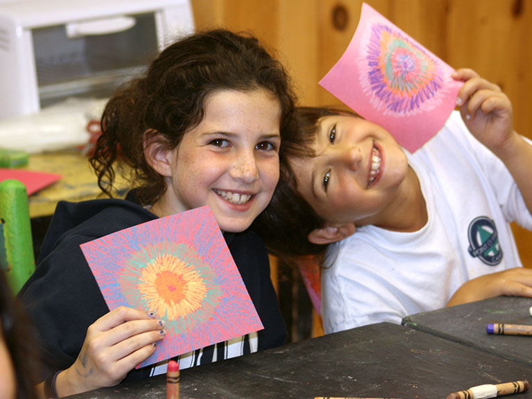 Summer campers and their artwork