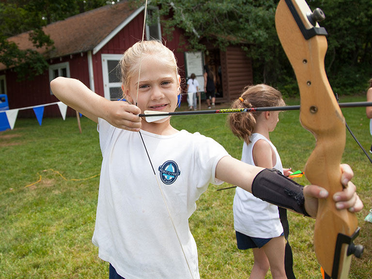 Campers practicing archery