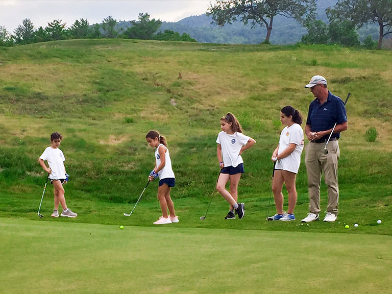 Golf instruction at sleep away camp