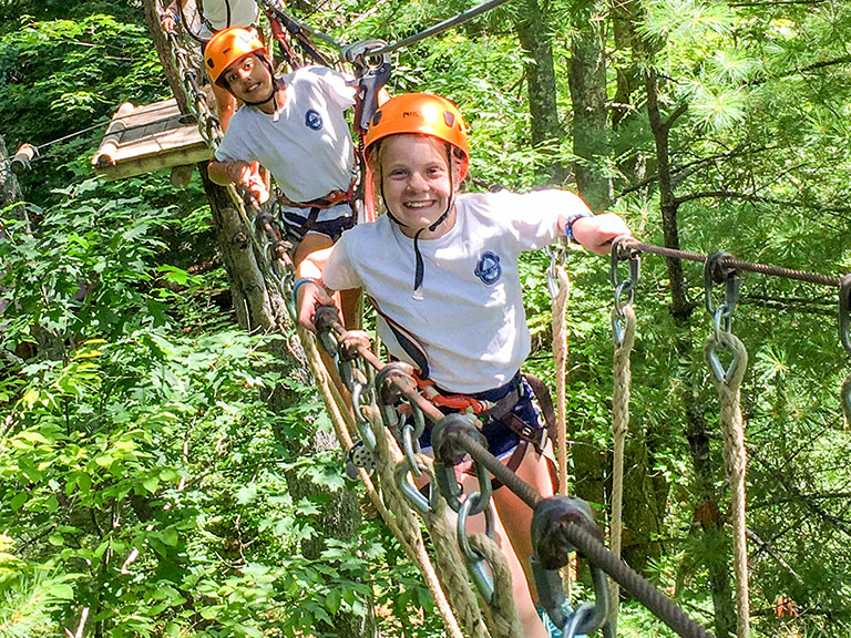 Campers on ropes outdoor adventure