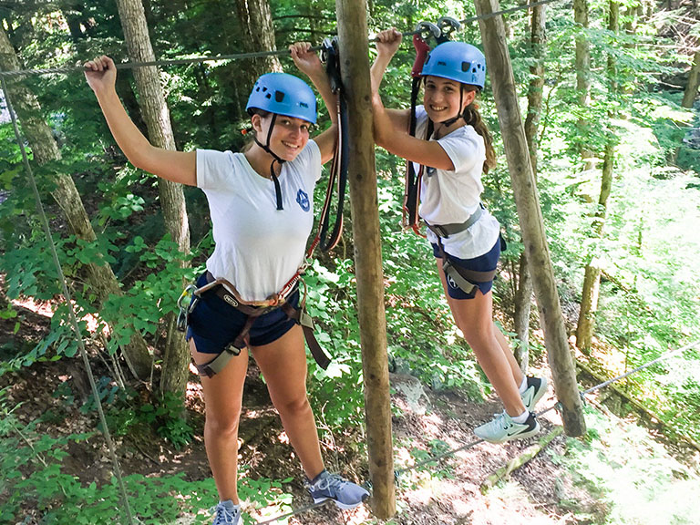 Sleep away campers on ropes course